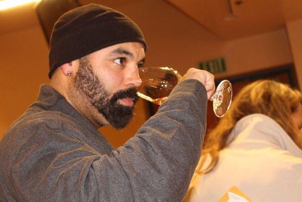 Chris Christensen tasting wine