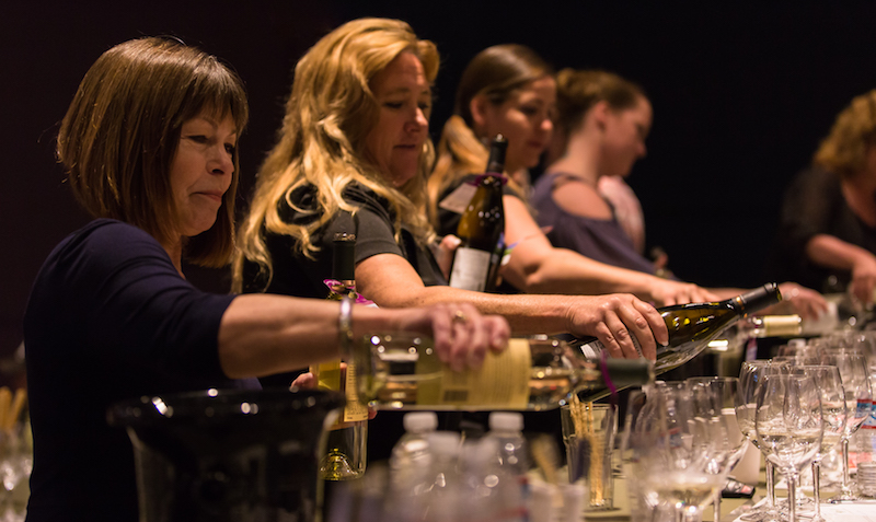 Group pours wine for technical tasting