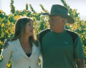 Ron and Deanna Bartolucci standing in vineyard