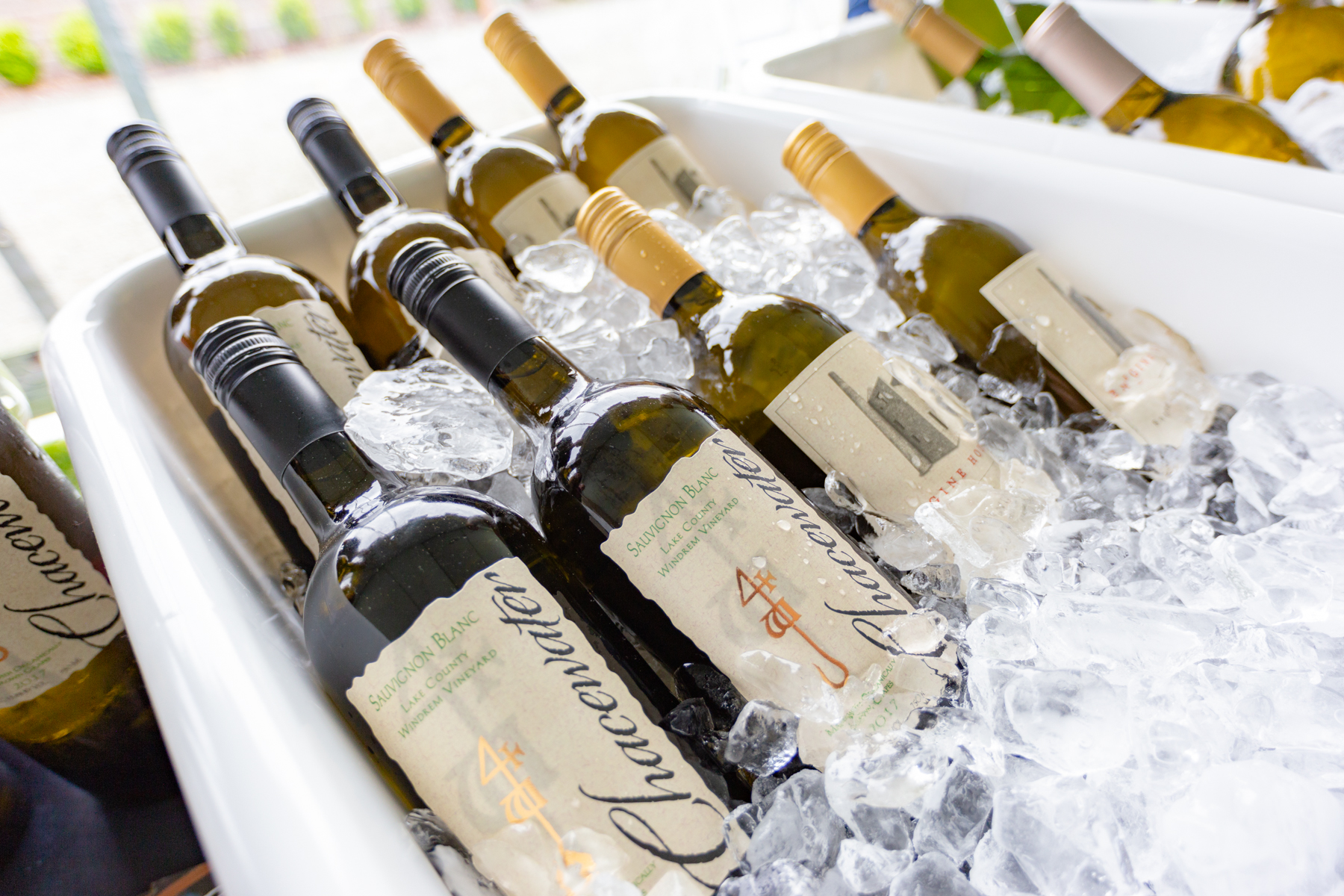 Sauvignon Blanc bottles chilling in ice tubs