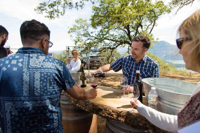 Matt Hughes pours wine at SOMM Camp