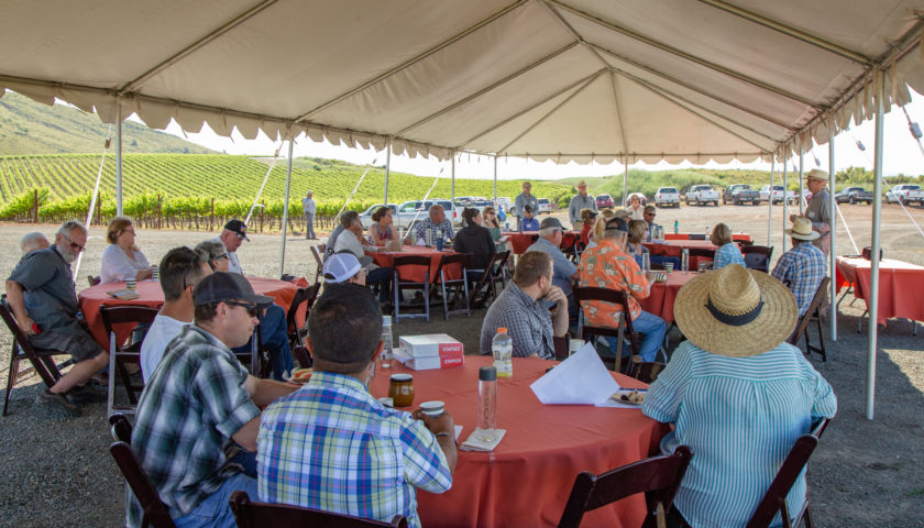 Implementing Sustainable Farming Practices workshop under tent