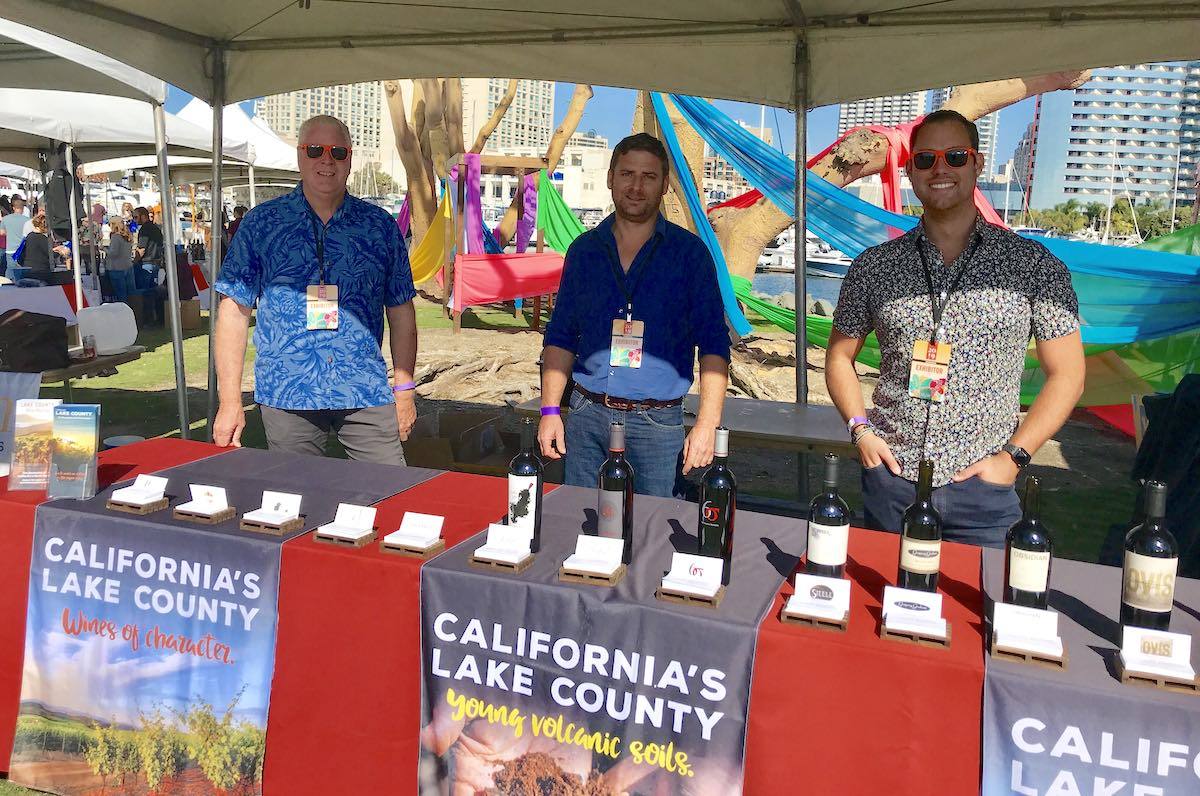 3 representatives from Lake County at San Diego Bay Food + Wine event getting ready to pour wine