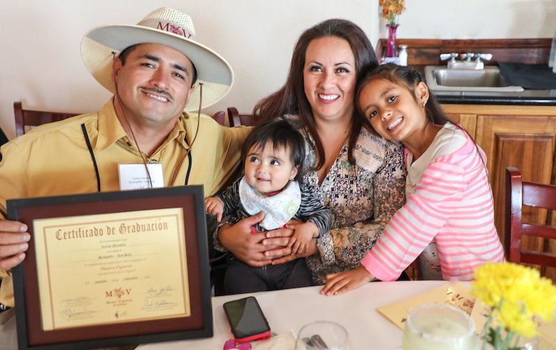 Student graduate of Lake County Master Vigneron Academy class of 2019 with his family