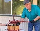 Glenn McGourty pressing wine